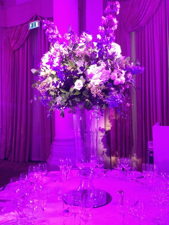 Lilac hydrangea. lilac roses in table centres for wedding at the langham Hotel London