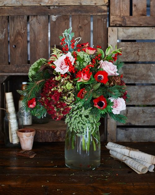 English hydrangea, tea-stained roses, ilex berries, red anemones, dill and wintery foliage